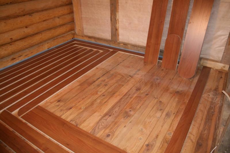Монтаж теплого пола на деревянное основание в фото