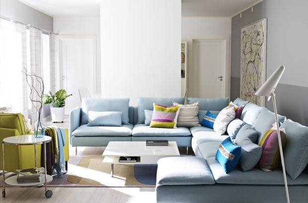 appealing-blue-sofa-chaise-and-colorful-pillows-interior-design-beside-white-coffee-table-inside-stylish-living-area-with-round-side-ta