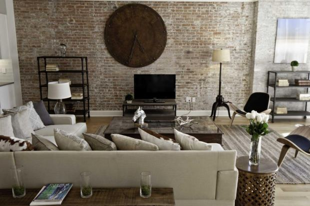 modern-industrial-bedroom-interior-design-brick-wall-scheme-with-wooden-big-circle-clock-beige-foamy-bed-sofa-set-l-shape-with-decorati