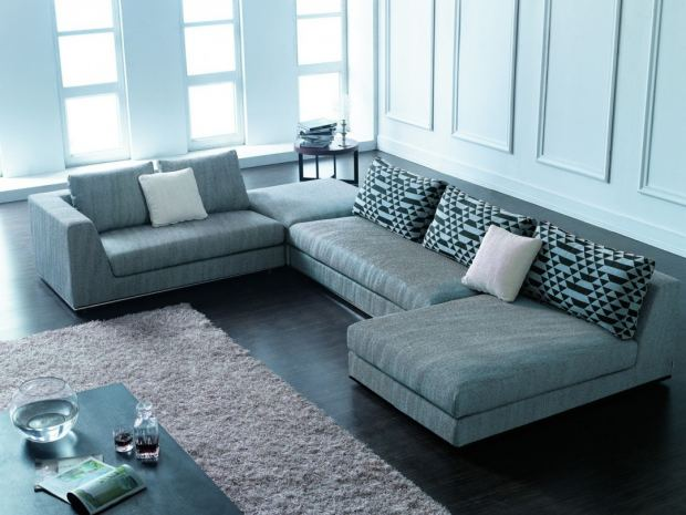 round-side-table-design-and-modern-sectional-sofa-with-decorative-pillows-also-shag-area-rug-and-black-living-room-floor-1080x810