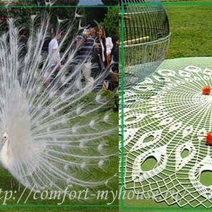 Вязание крючком большой круглой салфетки «Павлинье перо» в фото