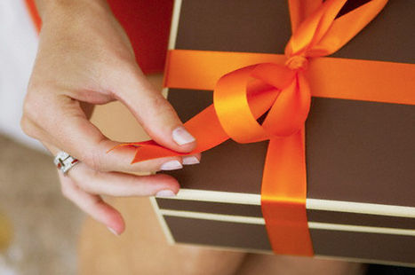 Woman Opening Gift --- Image by © Beau Lark/Corbis